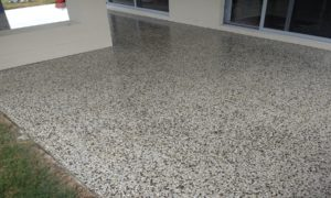 Rough washed aggregate surface was heavily ground down, surface voids repaired then honed to 100 grit - finished with 3 coats of solvent acrylic - Banksia Beach Bribie Island