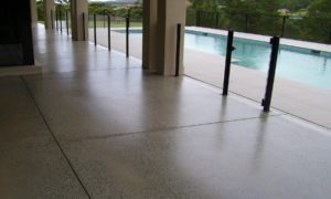 250 Sqm of covered paths and outdoor entertaining areas ground to reveal aggregates random effect - client selected acrylic UV resistant sealer to protect the investment