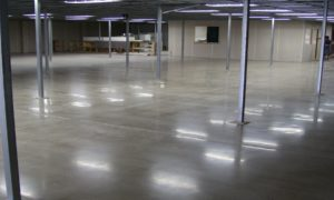 1400 Sqm of low to nil aggregate revealed Industrial polished concrete for a hardware store Kingaroy Qld